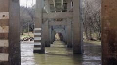Underneath roadway bridge river Stock Footage