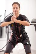 fit woman exercise on electro muscular woman - stock photo