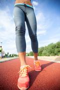 Runner feet running on road,woman fitness and welness concept. Stock Photos