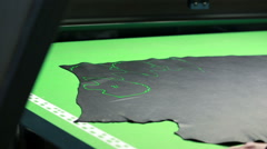 Placing patterns on leather section with laser Stock Footage