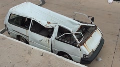Destroyed minibus top view Stock Footage