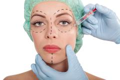 Injections of botox and cosmetic surgery concept - stock photo