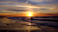 Fisher man at the atlantic ocean at sunset Stock Footage