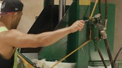 Man Pressing Freshly Shorn Wool in a Woolpress Stock Footage
