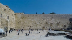 Time lapse Local People pray at the western wall Stock Footage
