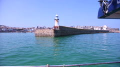 St Ives Lighthouse and Harbour from boat Stock Footage