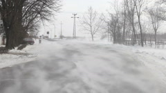 Drifting snow on winter road (1/3) - stock footage