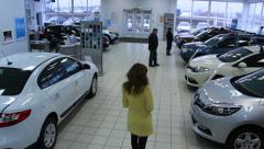 People are watching cars. Auto-dealer Stock Footage