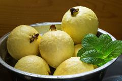 Yellow Guava with Mint leaves Stock Photos