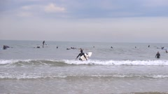 Wave surfing flat sea Stock Footage