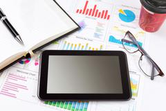 Tablet on working table. - stock photo