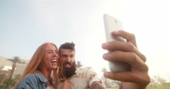Guy pulling funny face for a selfie with his girlfriend Stock Footage