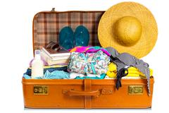 Nicely packed suitcase. Stock Photos
