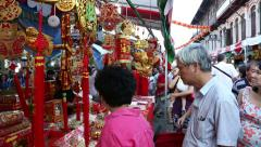 Festive trade on the eve of Chinese New Year in Chinatown in Singapore Stock Footage