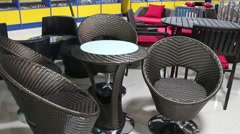 Rattan garden furniture in the shop Stock Footage