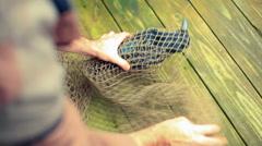 Bird caught in net 2 Stock Footage