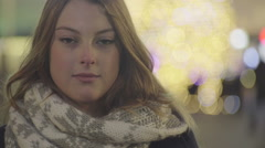 Young beautiful woman staring at the camera Stock Footage