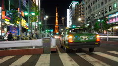 Time Lapse Busy Crosswalk in Shibuya at night with view of Tokyo Tower Stock Footage