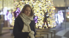 Young beautiful woman waiting Stock Footage