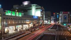 Zoom Out Time lapse Shinjuku station south entrance at night Stock Footage
