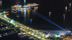 Harbor near Palm Jumeirah with yahcts and cars on parking at night close view Stock Footage