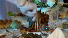 Cutting of grilled mutton ribs by a waiter in a restaurant. Stock Footage