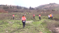 Search and rescue teams searching,field hospital earthquake Stock Footage