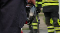 Firefighters equipment mask, mask in hand Stock Footage