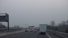 ULTRA HD 4K POV Point of view car drive busy freeway people commute highway fog - stock footage