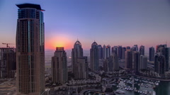 Sunrise in Dubai Marina with towers and harbor with yacht from skyscrapper Stock Footage