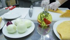 Different food ingredients on the table and cook preparing tortilas Arkistovideo