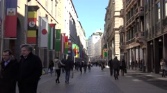 ULTRA HD 4K Busy pedestrian way Milan downtown expo 2015 sign banner flag rush  Stock Footage
