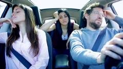 Three unhappy friends angry driving car Stock Footage
