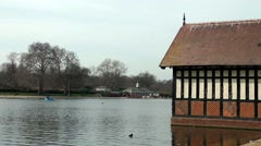 Boat house Serpentine Lake Hyde Park spring sunshine Stock Footage