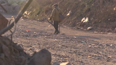 Old pauper on the garbage dumpl road 6 Stock Footage