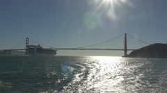 Big ship floating under the Golden Gate Bridge - stock footage