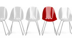 White plastic chairs and one unique red chair Stock Footage