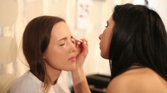 Visagiste makes makeup for  model, professional makeup artist Stock Footage