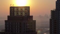 Sunrise in Dubai Marina with towers from top of skyscrapper, Dubai, UAE Stock Footage