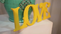 Decorative inscription Love,  decor, still life Stock Footage