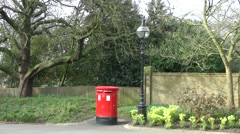 Red post mail box old lamp spring sunshine Arkistovideo