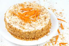 Fresh backed carrot sponge cake with walnut crumbs and carrots slices - stock photo