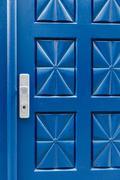 Closed blue door with pattern and aluminium handle Kuvituskuvat