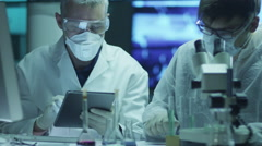 Team of Scientists is Doing Biological Researches and Writing Data into Tablet Stock Footage
