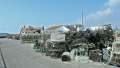 Crab and lobster pots at the docks Stock Footage