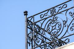 Wrought-iron black balcony corner - stock photo