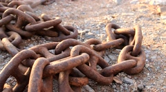 Stock Video Footage of rusty chain on gravel