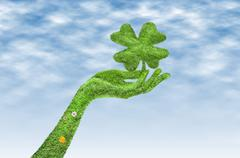 Hand with a four-leaf clover - stock illustration