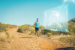 Stock Illustration of Composite image of athletic man jogging on country trail
