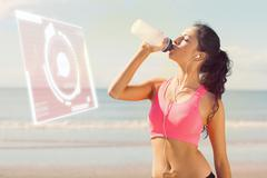 Stock Photo of Composite image of beautiful healthy woman drinking water on beach